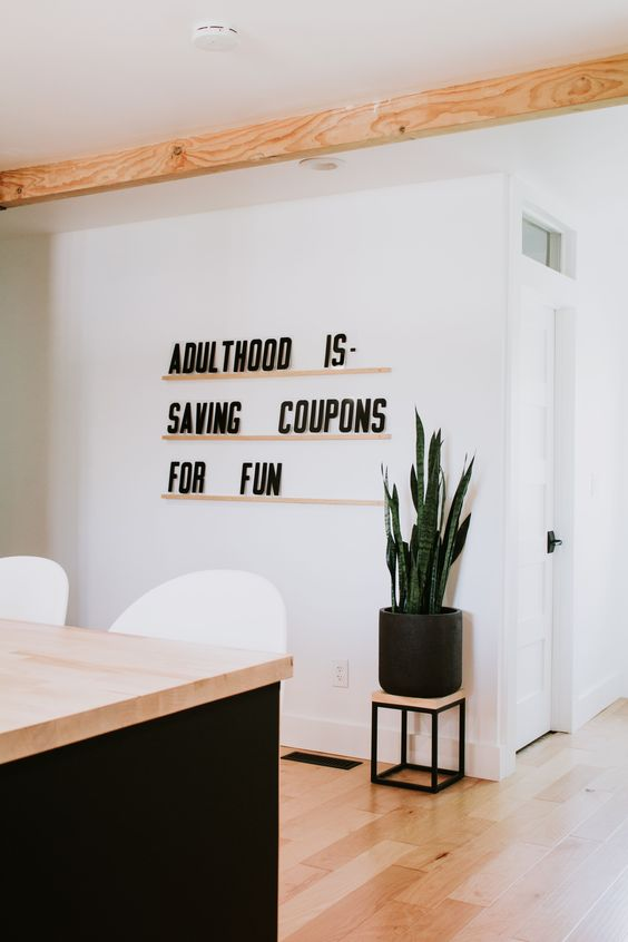 """""""Adulthood is saving coupons for fun."""" Funny quote by Nadine Stay. Letters & Ledges from Nadine Stay available at nadinestay.com. Modern wall decor. Giant letterboard for the modern home. #moderndecor #walldecor #letterboard #homedecor #wordart"""