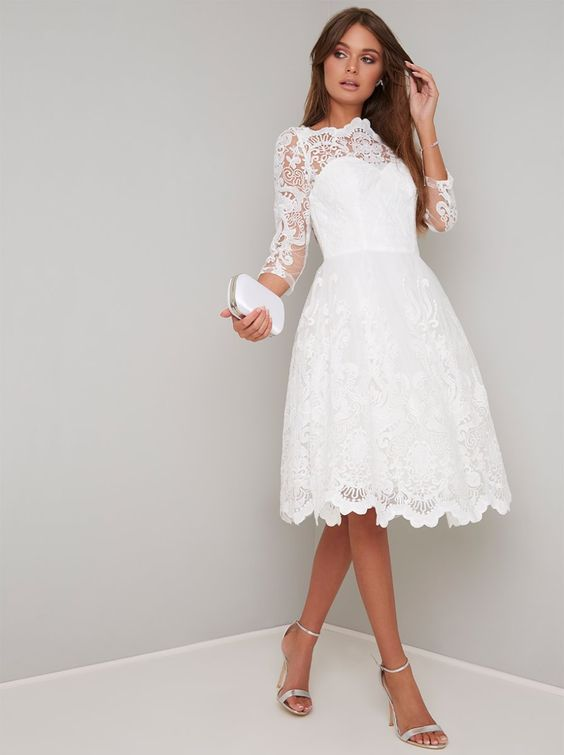 Play up to your feminine side in this beautiful white midi tea dress- features 3/4 length sleeves, embroidered mesh detailing, a fitted bodice, and a mesh underskirt.