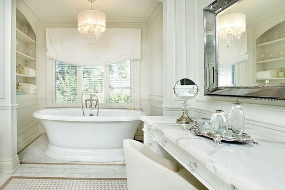 amazing bathroom lighting design ideas | This is the perfect bathroom lighting idea for a more classic design. If you have a tub area for those relaxing moments you can add a classic chandelier above to create an even more calm and delightful atmosphere. And in a classic luxury bathroom design the chandelier works as part of the decoration too.