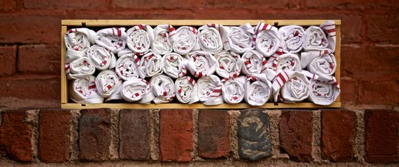 Rolled up napkins for dinner service on the patio at Belly Wine Bar, Kendall Square, Cambridge, MA