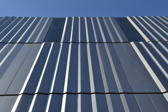 Corrugated Metal Panels Make Up Nearly Two Thirds Of The Building S Facade Albert Vecerka Esto Nanotechnolog Metal Panels Facade Metal Facade Nanotechnology