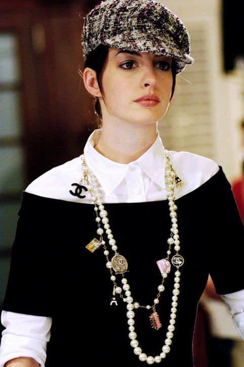 The Devil Wears Prada Turns 10! 12 Looks from the Movie We're Still Obsessed With...... Andy layers like a pro with a button-down, off-the-shoulder-top, and graphic pearls.: