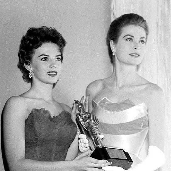January 29, 1956 - Natalie Wood and Grace Kelly at a Directors' Guild dinner, USA.