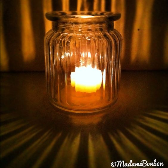 A tealight jar - scalloped lolly jar gives off a beautifully refracted glow.