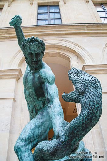 Sculpture of Hercules and the serpent at the Louvre museum in Paris