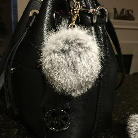 Genuine rabbit fur key chain Genuine rabbit fur key chain. Beautiful light Grey. Medium size. NWT. never used. Just for pictures. Very soft and fluffy. Use for your keys or hang on your purse. Bags