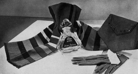 Les Modes (Paris) January 1937 Echarpe – sac et gants de nuance « Arbois » l'écharpe est doublée de satin rayé, de couleurs vives.  Parfum « moment suprême ». Parure de Jean Patou  https://flic.kr/p/y3hnaf