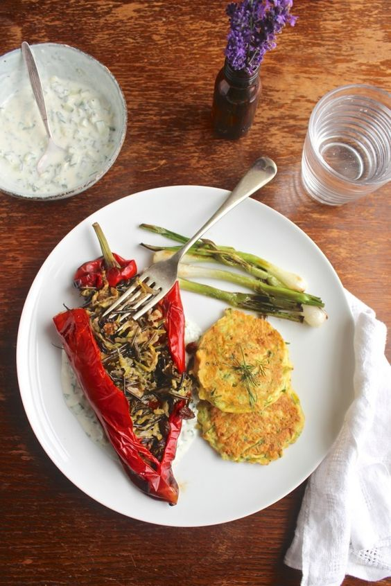 A Mediterranean inspired dish combining stuffed Romano peppers with a wild rice and courgette filling, courgette fritters and charred spring onions.:
