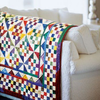 Make Your Point designed by Mabeth Oxenreider is a scrappy sensation that is composed of two straight-set blocks. Careful color placement creates the illusion that they're set on point. Free pattern from All People Quilt