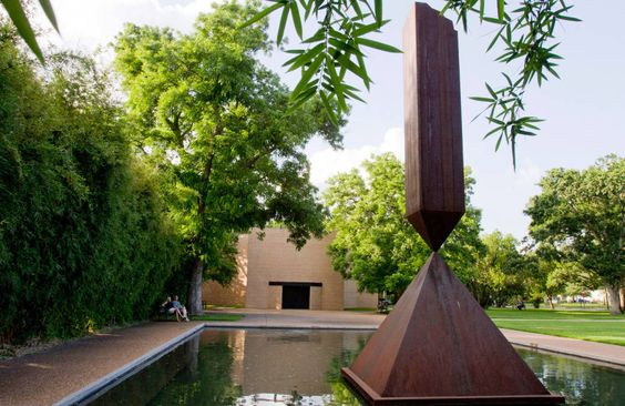 Broken Obelisk, a 1963 sculpture by Barnett Newman, which stands in the reflecting pool at the Rothko Chapel.