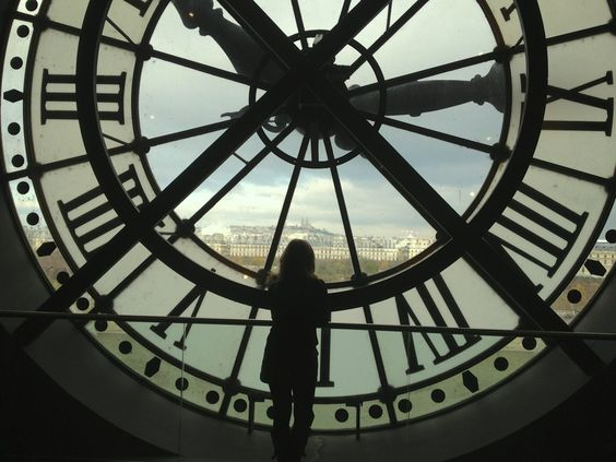 Lost in wonder | Enjoying the view of the Sacre Coeur from inside the Musee d'Orsay clock tower | Image via budgettraveller.org