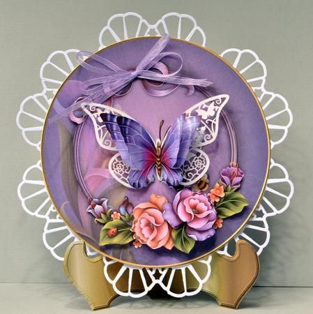 Enchantment Plate Card Mini Kit on Craftsuprint designed by Karen Adair - made by Kristina Norbat - Printed on 250gsm card cutout and layered with foam tape I then attached to a 7x7 diecut doily I then added a diecut butterfly and attached decoupage on top I added a lilac bow to complete this stunning design has a gold matching stand must have for the craft box. - Now available for download!