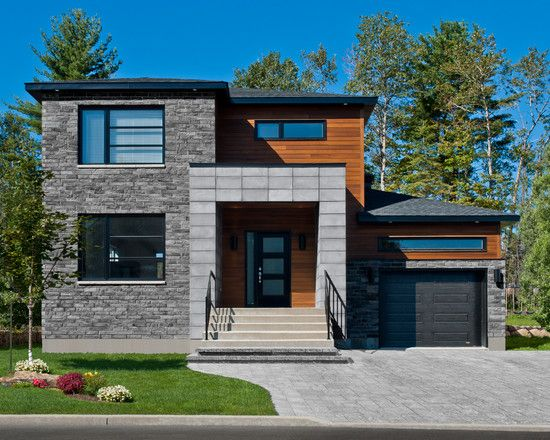 Garage contemporary home facade with modern black garage for Wooden house exterior design