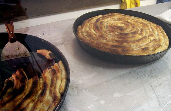 Croatian Burek (can be meat, cheese, or fruit, like apples) cheese filled pastry.