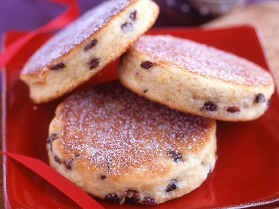 """Welsh Cookies - also called """"Welsh Cakes.""""  Not as sweet as regular cookies; more like a cross between a scone and an english muffin.  Best served warm, slathered in butter, alongside a cup of tea."""