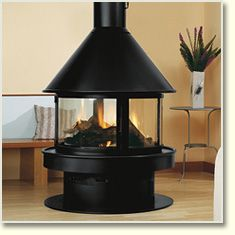 Rocal Gala woodburning stove.  I love the idea of an indoor fireplace that can be viewed from all the way round it.