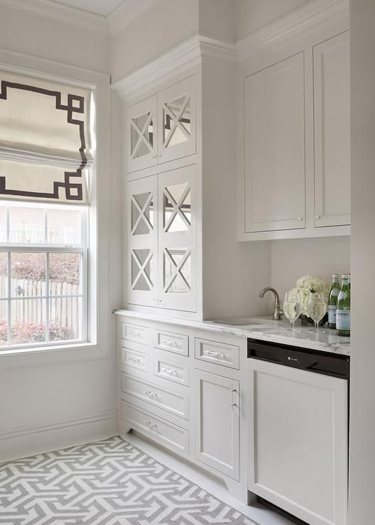 White and gray butler's pantry features white shaker