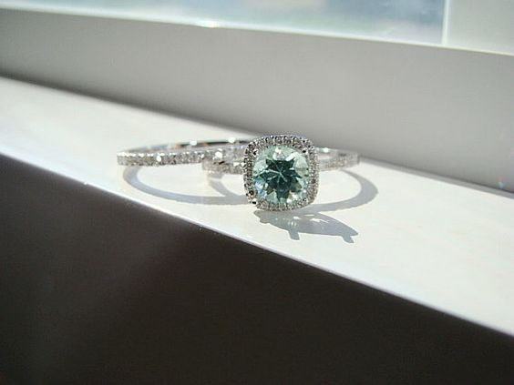 Mint green sapphire engagement ring.