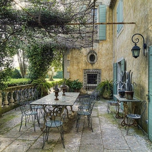 love this, looks like an oil painting but those place exist in Europe in many countries take some of the ideas and create them in your yard / patio areas: