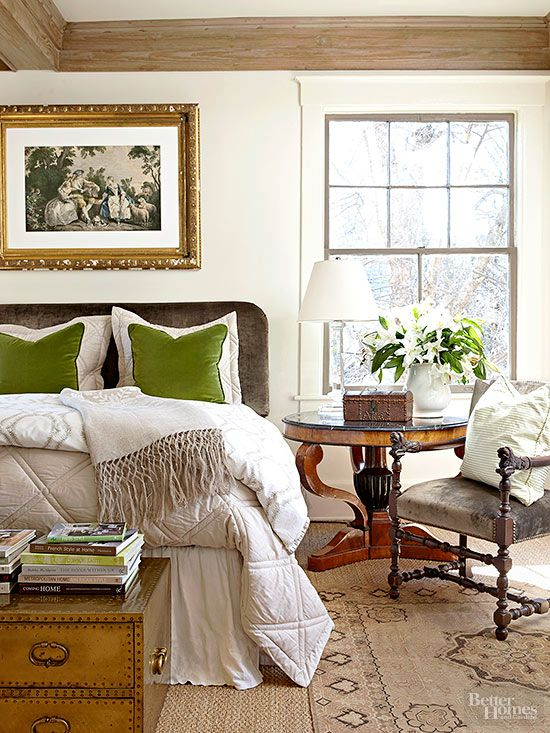 pop of color green pillows in neutral bedroom