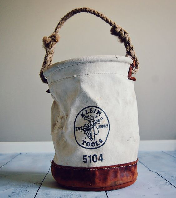"""Vintage Klein Lineman's Tool Bag #5104. Bucket style with a leather bottom and rope handle. Very sturdy.  Measures 15.5"""" tall by 12"""" in diameter.  Awesome vintage shape - scuffs and all!  https://www.etsy.com/listing/161462704/klein-linemans-tool-bag-5104"""