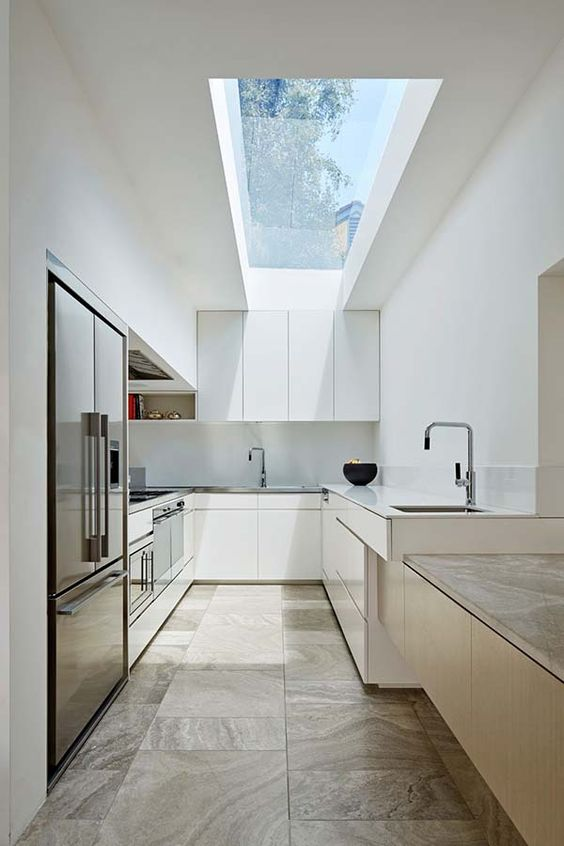 Fabulous contemporary renovation to Victorian home in Australia - Mixing white and wood cabinet finish.