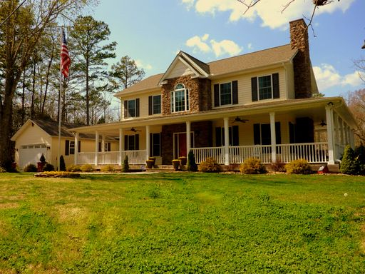 Southern dream home full wrap around porch 2 story for Full wrap around porch log homes