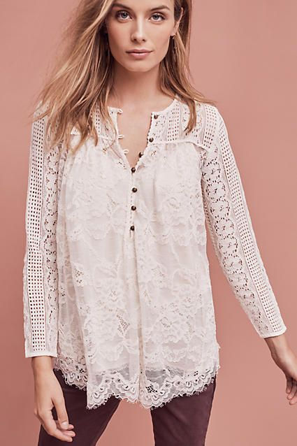 The Scalloped Lace Henley is a must-have for any modern bohemian wardrobe. Add a touch of lace to your fall wardrobe with this modern henley.