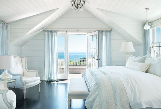 Ahhhhhhhhhh--waking up to the sound of the ocean would be heaven on earth. Soft blues and whites just blend in with the scenery outside in this exquisite bedroom.