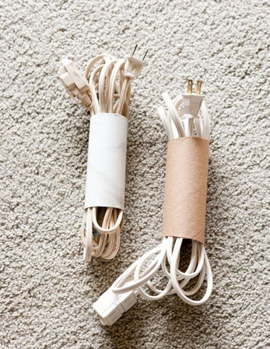 use empty toilet paper rolls (or cut a paper towel roll or wrapping paper roll) to corral extension cords and wires. The rolls can be covered with contact paper to make them prettier and sturdier.
