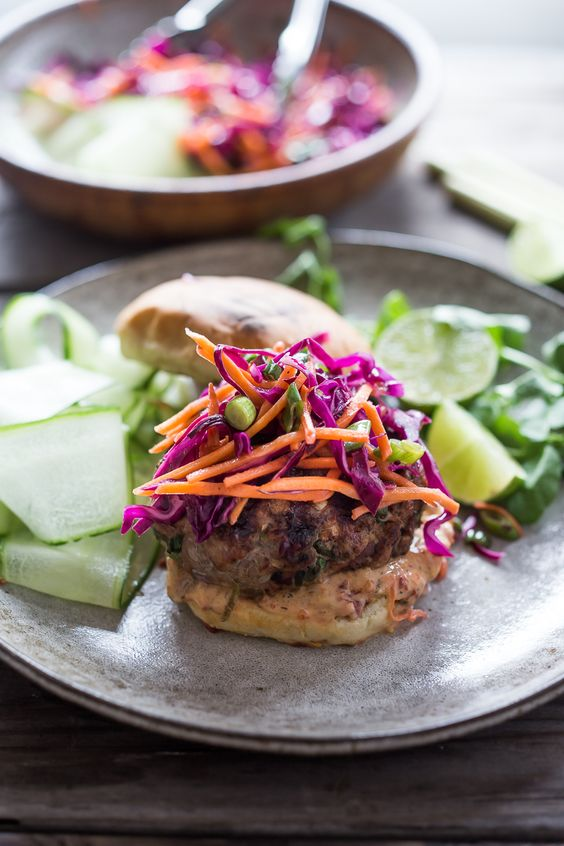 A Delicious recipe for Thai Turkey Burgers- with lemongrass, ginger & basil, topped w/ a Crunchy Asian Slaw and Spicy Aioli. Light, healthy, FLAVORFUL! Easy to make. | www.feastingathome.com #thaiturkeyburger #thaiburger #turkeyburger