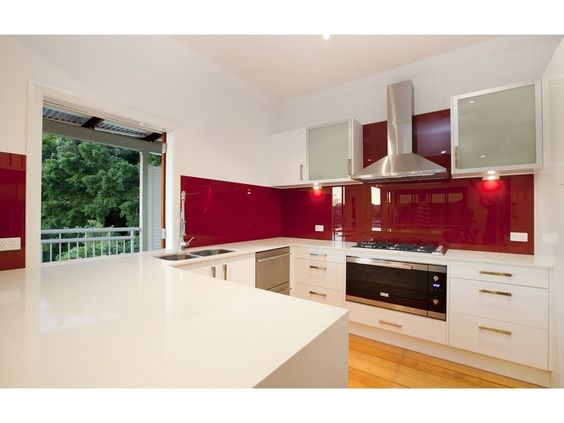 Modern u shaped kitchen design using frosted glass for Modern u shaped kitchen designs