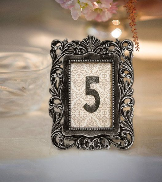 Frame the Table numbers with vintage paper print...Vintage Victorian Wedding Table Number Sign in Frame 1 - 9.  via Etsy.