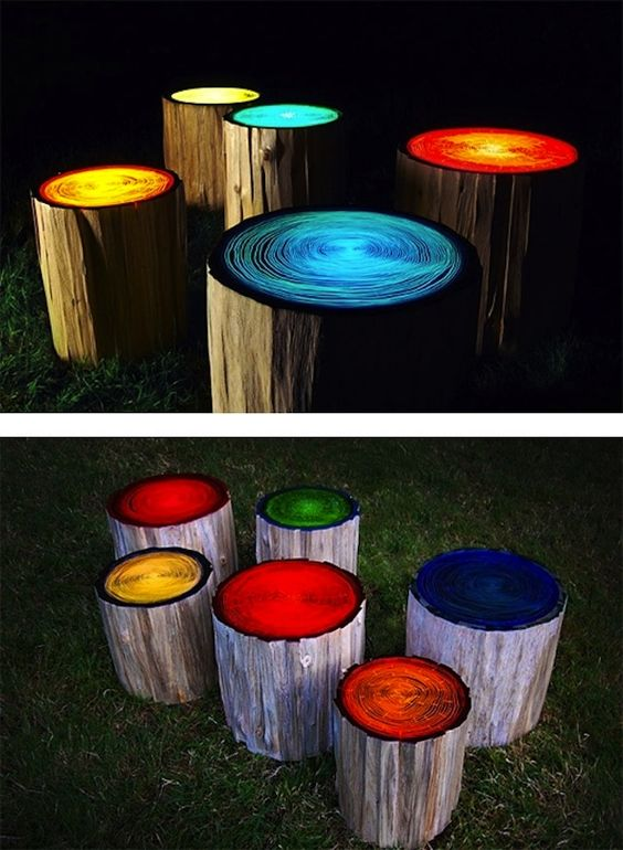 Log Stools painted with glow in the dark paint. What an easy way to spice up your backyard seating area or very cool for the campfire.