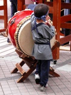 japanese-boy-playing-taiko-drum-at-festival.jpg