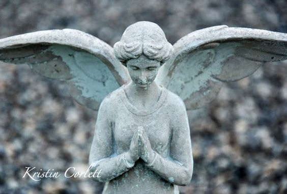 A painted angel in the Prince of Peace cemetery in Elberta, Alabama