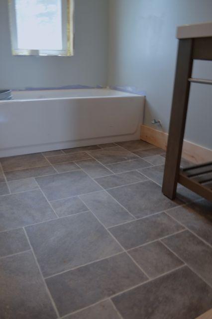 Barn bathroom laminate floor2 -- I want this vinyl flooring in my renovated master/main bathroom!!!