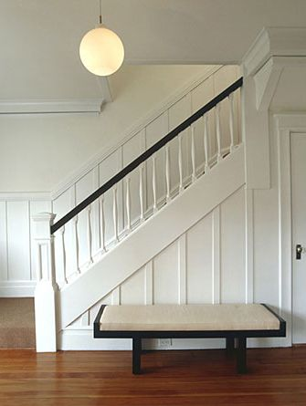 simple: Bernstein Architect,  Handrail, Living Room, Modern Staircase, Paneled Wall, Board And Batten, Newel Post, Cary Bernstein