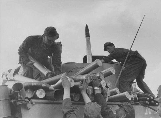 """German tank crew Loading shells on a Pz.Kpfw.VI """"Tiger"""", 1943 Russia, Kursk."""