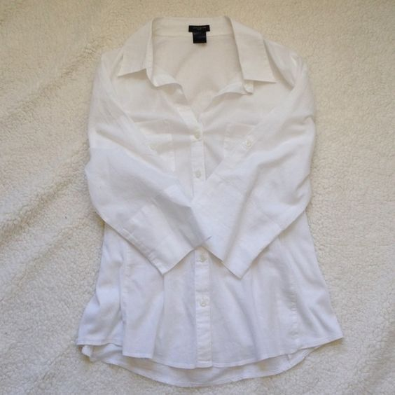 Ann Taylor white button down Beautiful Ann Taylor white button down! Size 10. Does have a few small stains on front of shirt as shown above. Smoke and pet free home. Make an OFFER today! Happy Poshing!  Ann Taylor Tops Button Down Shirts