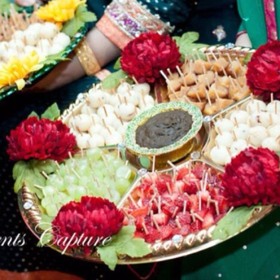 Mehndi Thaal Decoration Ideas I : Rasam tray cut sweets up and put cocktail sticks in