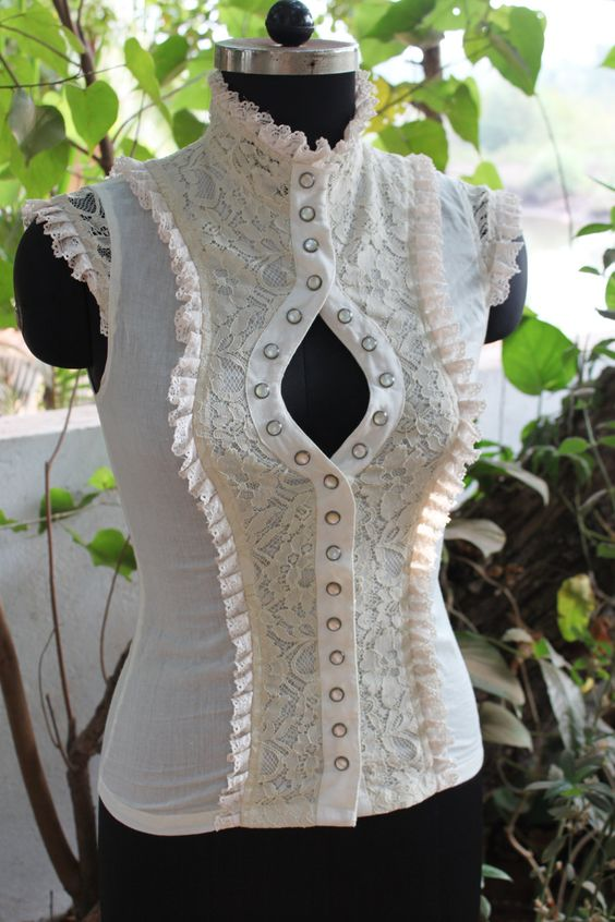 How CUTE would that be with an underbust steampunk corset? Answer? SO VERY. [Razzle top - Off white.$87.04, via Etsy. [overshirt]