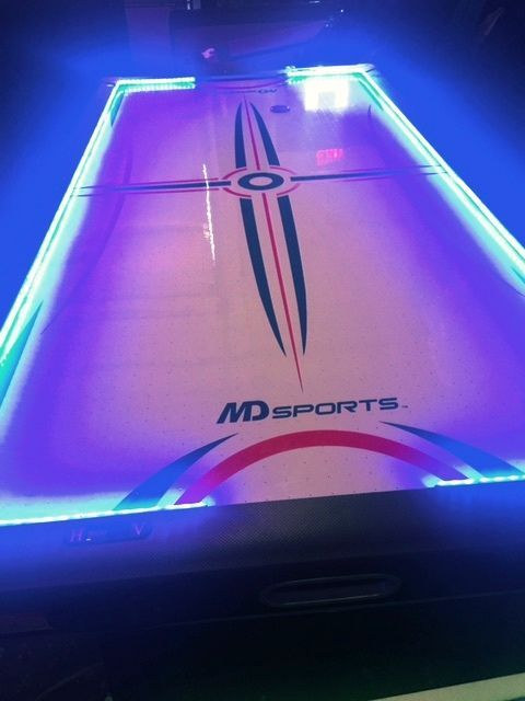Glow In The Dark Air Hockey Tables Neon Light Air Hockey Table Fun Arcade Games Chicago Party Rentals In 2020 Air Hockey Table Carnival Game Rentals Air Hockey
