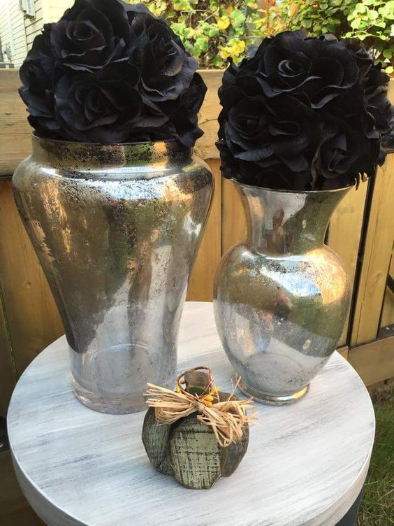Make your own Mercury glass! All you need is 1/2 vinegar and 1/2 water in a spray bottle, and spray until droplets appear. Then, spray Krylon Looking Glass spray paint over top. Blot after 30 seconds. Repeat until desired look is created ~The Decor Vault~