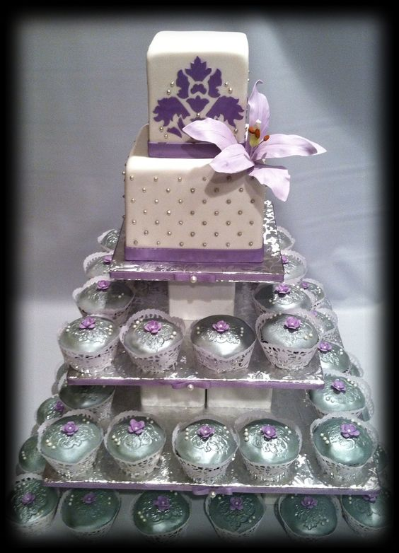 The cupcakes were embossed and sprayed silver.