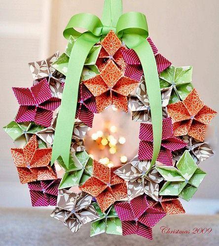 Origami wreath. Instructions for these origami cherry blossoms are on Google docs (https://docs.google.com/viewer?url=http://server.brabec.com/origami/wreath_petals.pdf).