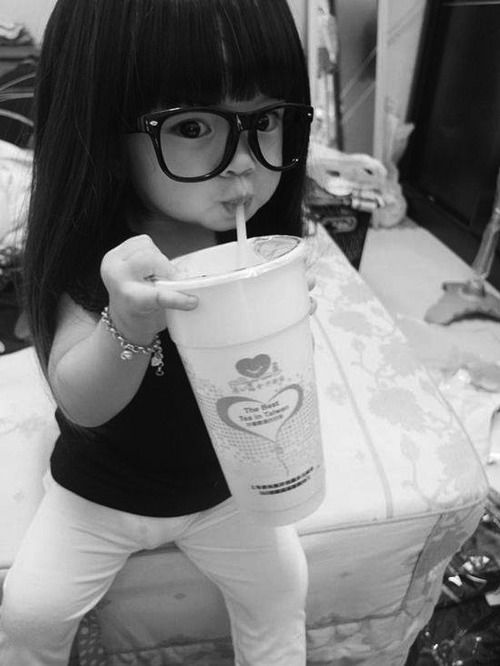 I don't like seeing little kids with soft drinks, but she's so darned cute!