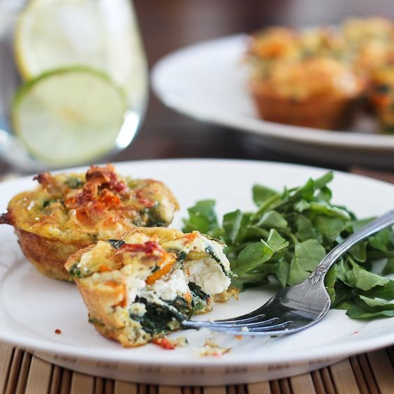 Spinach, sun-dried tomatoes and feta frittata bites.