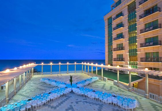 This terrace space overlooking the ocean at Sandos Cancun Luxury Experience Resort is truly awe-inspiring! #reception #inspiration