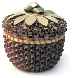 """Native American Strawbery basket. Nick Clark, president of the National Center for Great Lakes Native American Culture, has to say, """"The Strawberry Basket is made for and given to new-born babies and it is a treasure kept through their entire life and taken with them to the Spirit World. A piece of their umbilical cord is kept in the basket along with other things of special meaning so the ancestors will recognize them when the arrive in the Spirit World."""